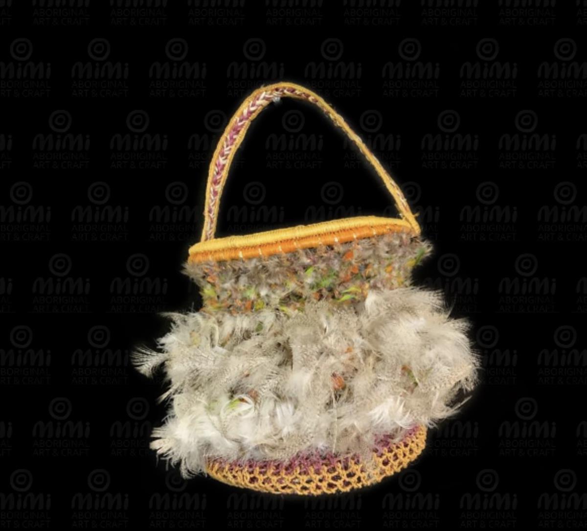 Netted pandanus basket with feathers by Dorothy Dullman Bienanwangu